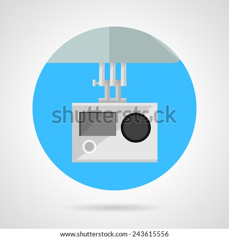 Extreme sport camera flat vector icon. Blue colored round vector icon with gray fixed action camera for extreme sport or drone monitoring on gray background. Flat design with shadow. - stock vector