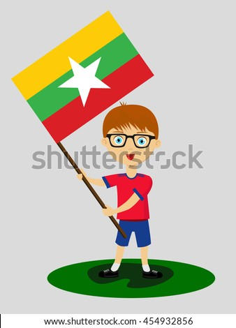 Fan of Myanmar national football team, sports. Boy with flag in the colors of the state command with sports paraphernalia.