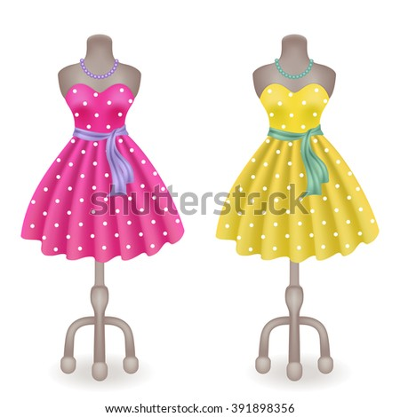 Fashionable dress with polka dots in retro style on dummy in shop or salon store