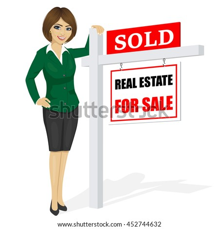 Female real estate agent standing next to a sold for sale sign