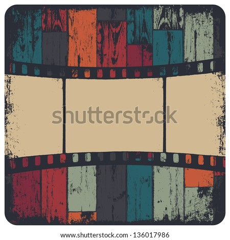 Film strip in grunge frame on colorful seamless wooden background. Vector, EPS10 - stock vector