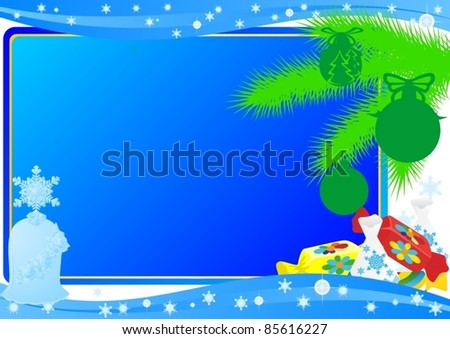 Fir branch with tree ornaments and candy in the background abstract blue background.