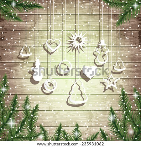 Fir tree branches and hanging toys on the wooden board background. Christmas vector illustration.