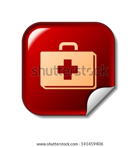 First aid kit icon on red sticker