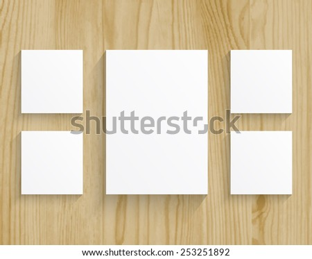 five boards blanks sheet of paper on wood texture background - stock vector
