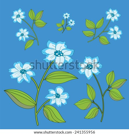 five delicate blue flowers isolated on light blue background