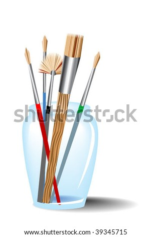 Five paintbrushes in jar