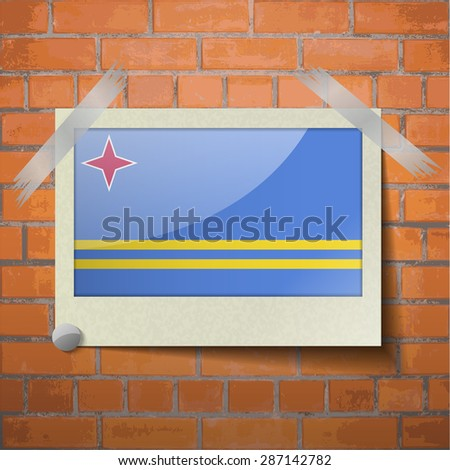 Flags of Aruba scotch taped to a red brick wall. Vector - stock vector