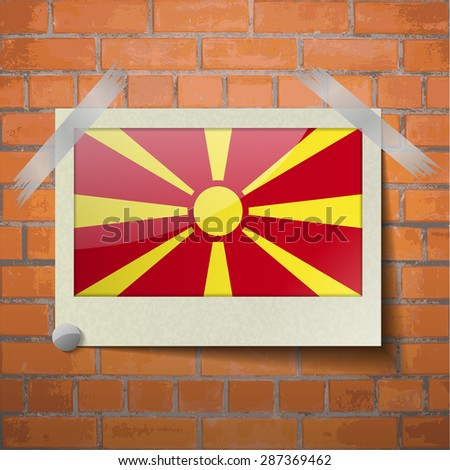 Flags of Macedonia scotch taped to a red brick wall. Vector - stock vector