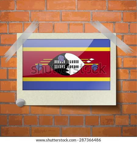 Flags of Swaziland scotch taped to a red brick wall. Vector - stock vector