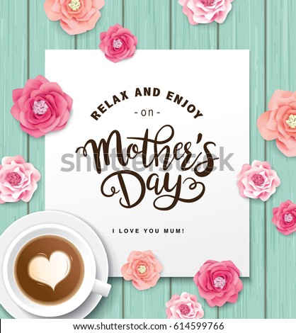 Flat lay style mother`s day greeting card with coffee cup and flowers on wooden table.