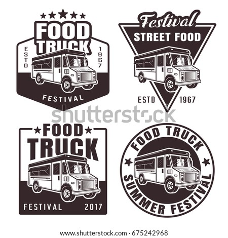 Food truck set of four black vector emblems badges stickers or logos in vintage