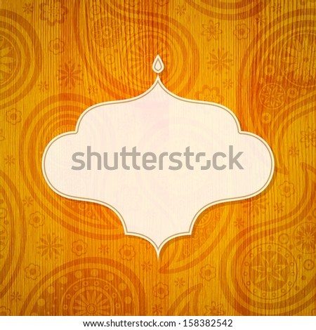 Frame in the Indian style on the wooden background with paisley pattern. Vector illustration. - stock vector