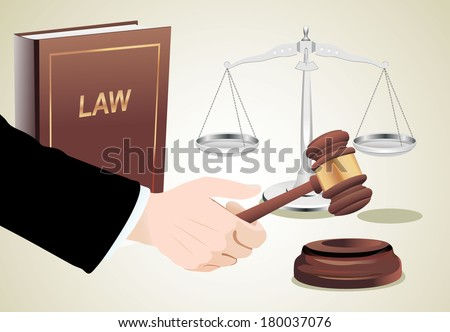 Gavel in hand, scales of justice and law book