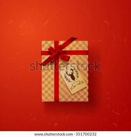 gift box with red ribbon bow with deer label - stock vector