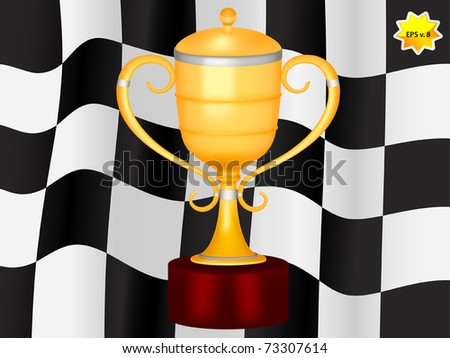 Gold trophy on chequered flag