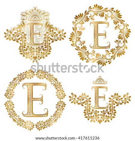 Golden letter E vintage monograms set. Heraldic coats of arms and round frames. - stock vector