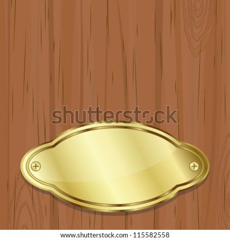 Golden plate over wood