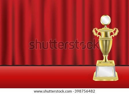 golden trophy with red curtain background
