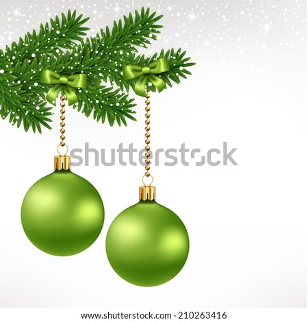 Green christmas balls on fir tree with ribbon