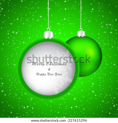 Green christmas bauble on sparkling background with place for your text inside.