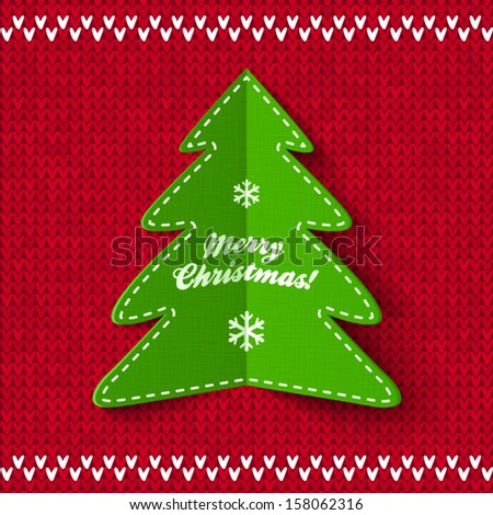 Green Christmas tree applique on red knitted background - stock vector