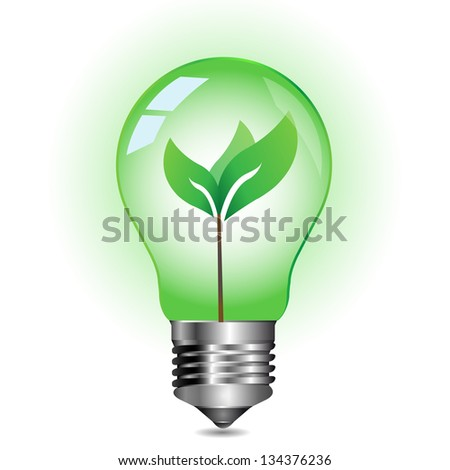 Green energy concept, plant growing inside the light bulb
