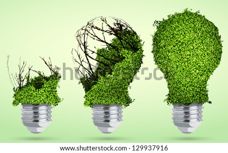 greening light bulb out of the grass - stock vector