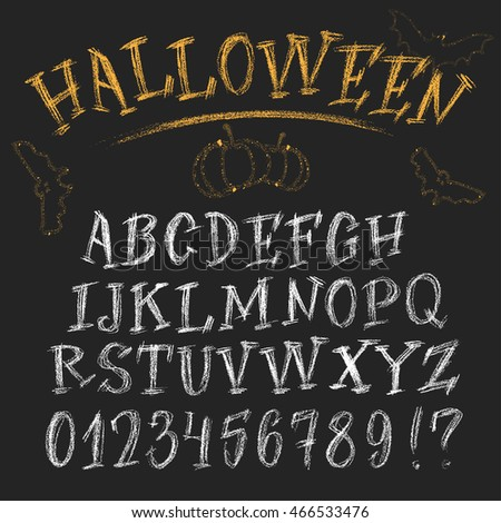Halloween chalk roman alphabet. White hand-drawn letters set on dark background. Funny  decorations of bats and pumpkin.