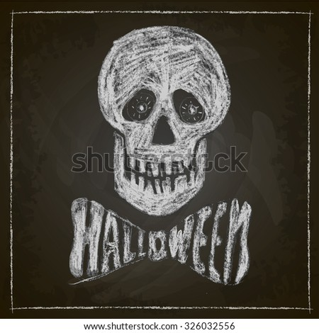 Halloween, skull drawn in chalk on a blackboard