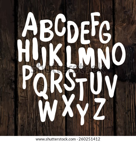 Hand-drawn Alphabet on Wooden Texture - stock vector