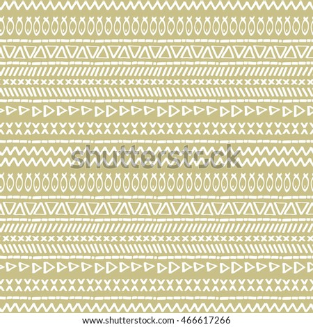 Hand-drawn  doodle. Vector seamless ethnic pattern with graphic shapes and tribal elements.  texture in boho style.