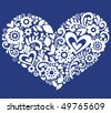 Hand-Drawn Flowers, Leaves, and Swirls in the Shape of a Heart- Vector Illustration on Blue Background - stock vector