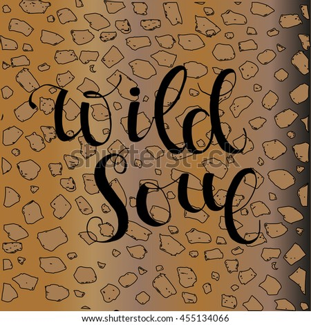 "Hand drawn  lettering phrase "" wild soul"" in english with leopard pattern. Vector illustration."