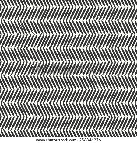 Hand drawn style chevron seamless pattern. Abstract geometric tiling background in black and off-white. - stock vector