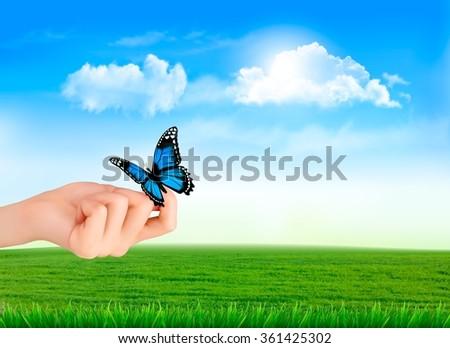Hand holding a butterflies against a blue sky. Vector illustration.  - stock vector