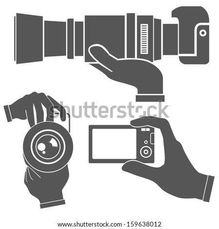hand holding camera, hand set - stock vector