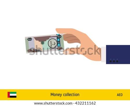 Hand holding money vector illustration. United Arab Emirates dirhams banknote. - stock vector