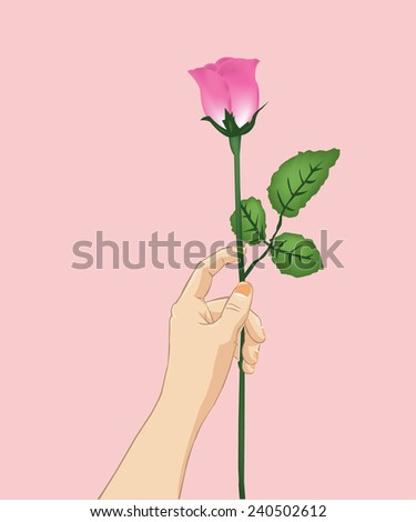 Hand holding rose.