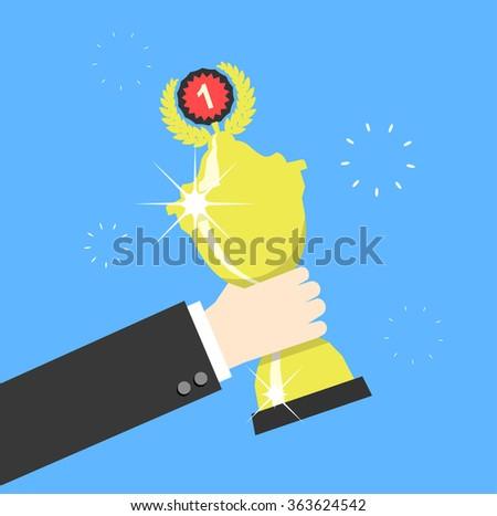 Hand holding winner's trophy award. Vector illustration - stock vector