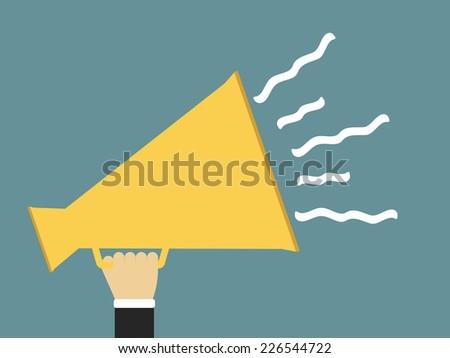 Hand holding yellow megaphone, promotion concept, flat design, vector eps10 illustration - stock vector