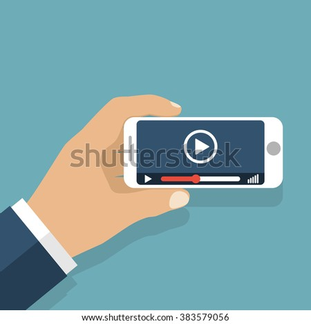 Hand holds smartphone. Video player application on your mobile phone screen. Watching videos on the phone.  Vector flat. Mobile video streaming technologies. Watching Video. - stock vector