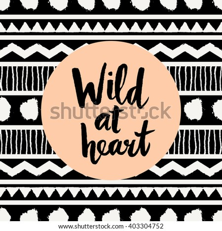 """Hand lettered inspirational quote """"Wild at Heart"""", pastel orange colored circle, tribal geometric pattern background. Modern greeting card, poster, t-shirt design. - stock vector"""