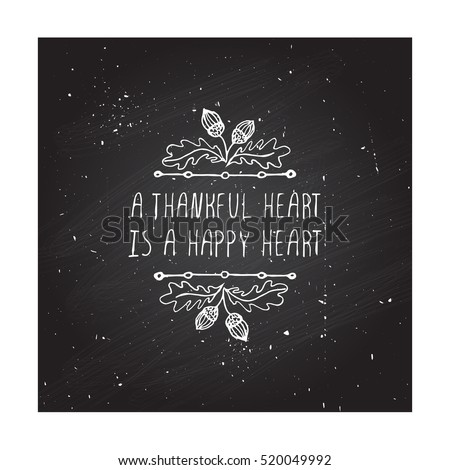 Handdrawn thanksgiving label with acorns and text on chalkboard background. A thankful heart is a happy heart.