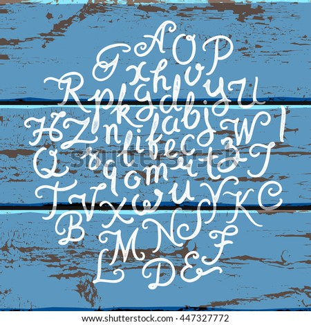 Handwritten alphabet font. Hand drawn brush script letters on the old painted wood panels background. Stock vector lettering typography - stock vector