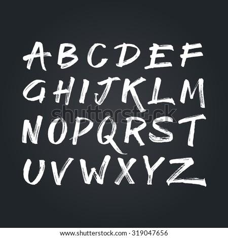 Handwritten calligraphic white alphabet written with brush pen on black chalkboard background. Handmade abc font typography - stock vector