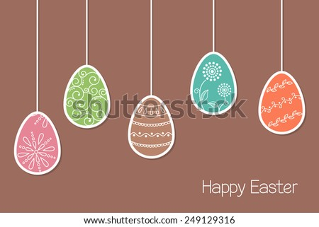 Hanging Easter eggs in paper cutout style with decorative ornaments - stock vector