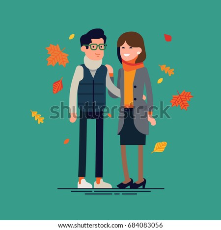 Happy couple in autumn season clothes. Cool vector flat character design on autumn or fall season couple standing holding each other surrounded by falling leaves
