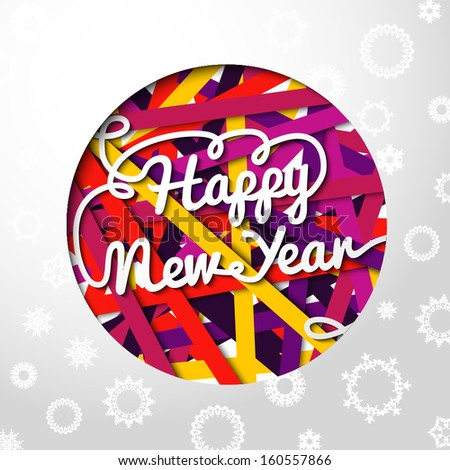 Happy New Year handwritten swirl lettering on greeting card made from bundle of bright laces on the paper with snowflakes, and cut through paper in shape of christmas ball. With place for your text.