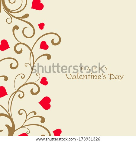 Happy Valentines Day celebration concept with beautiful floral design and pink heart shapes with space for your message.